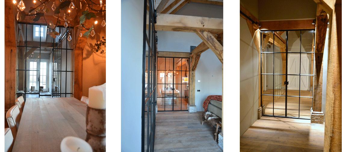 Deze schuifdeur is mooi weggewerkt in het balkenplafond.