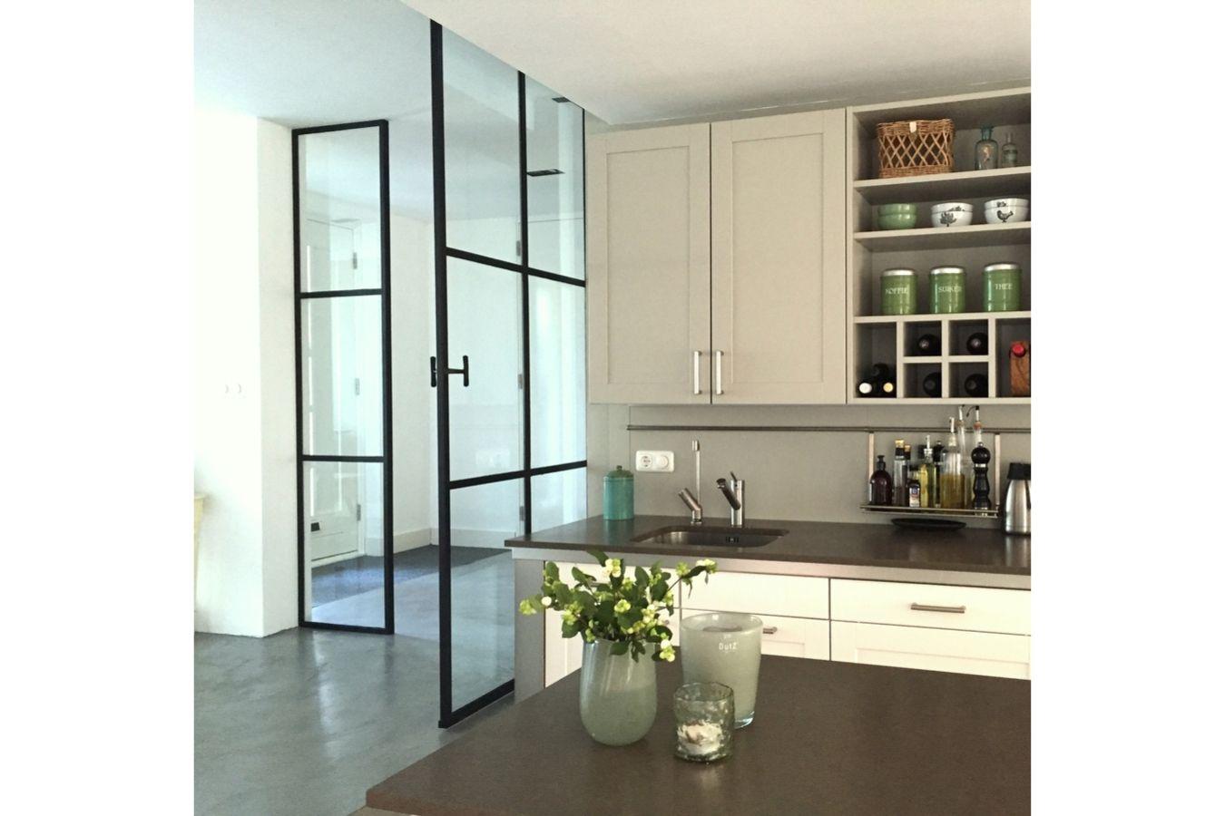 Stalen taatsdeur, stalen binnendeur, stalen binnenpui gerealiseerd door StalenDeurenHuys - Stalen deuren