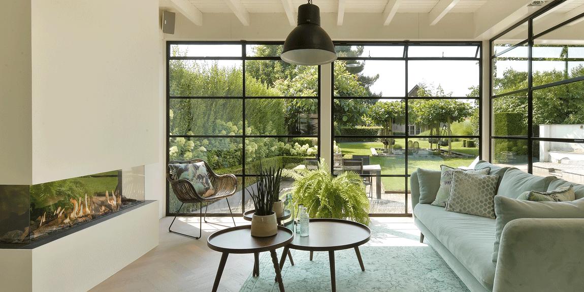Deze tuin kamer wordt één met de omliggende natuur.