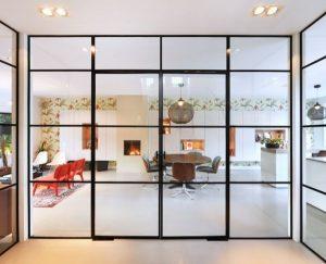 stalen binnendeuren in Zeist - stalen deuren woonkamer - stalen deuren op maat - stalen deuren met glas - pivotdeuren - stalen deuren in Nederland
