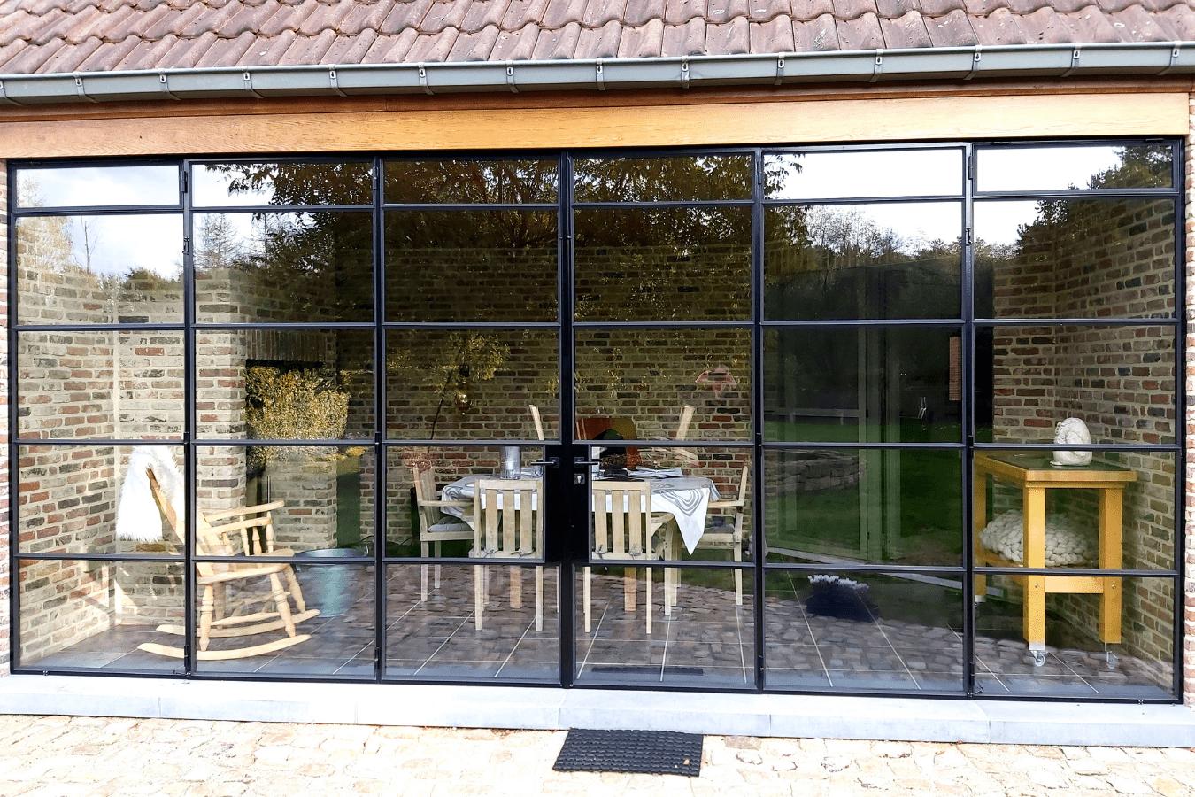 tuinhuis met stalen vouwdeuren op maat, project langdorp, stalendeurenhuys